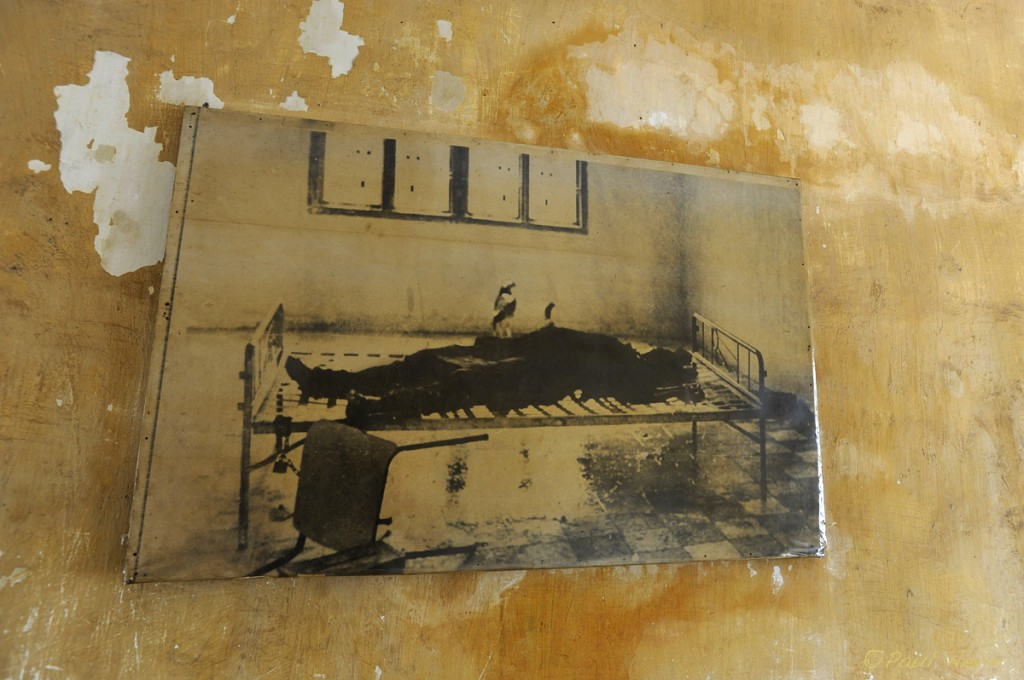 The body of one of the last 14 victims found tortured and murdered by the Khmer Rouge before they fled in the face of the Vietnamese invasion. Note bird on top of corpse.