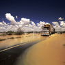 Stock photo flood flooding transport semi trailor yellow water